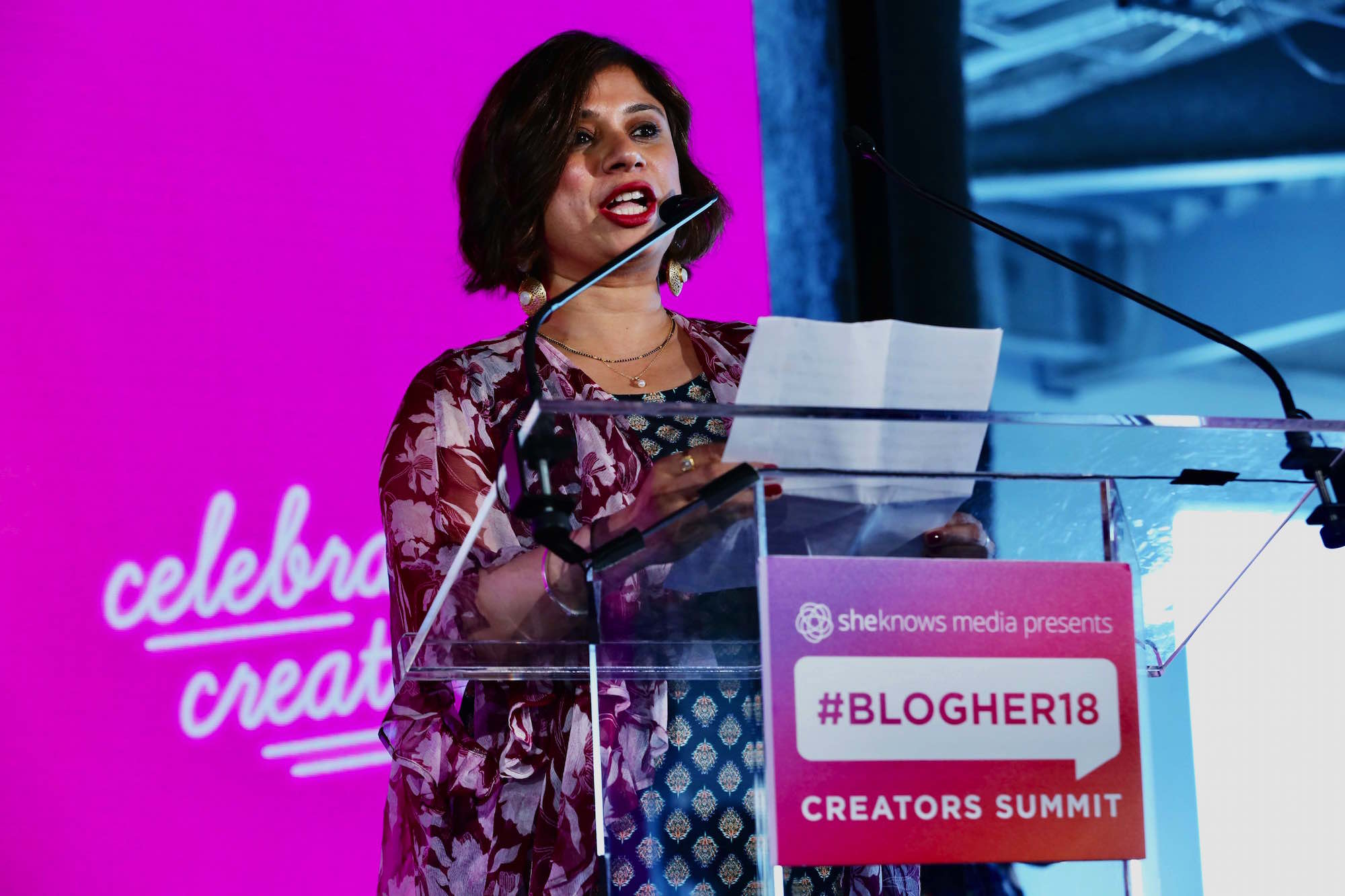 Sweet Vikram onstage at BlogHer 2018 Summit at Pier 17 in New York City.